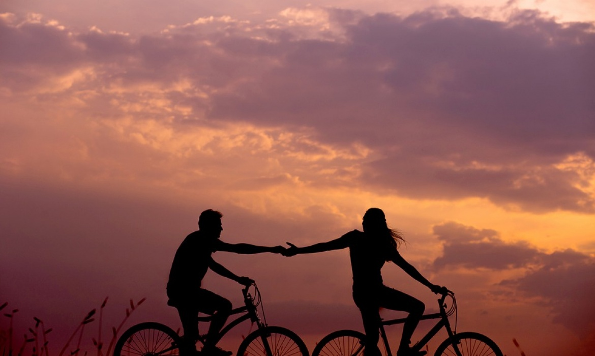 Cyclist holding hands